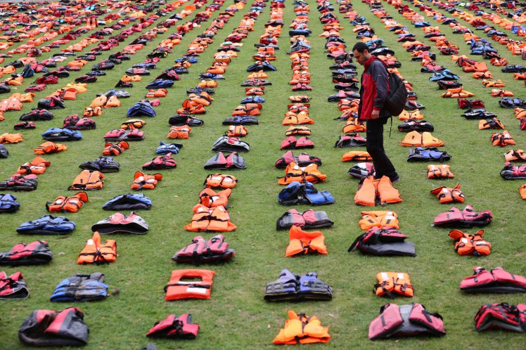 Parliament Square transformed into a 'graveyard of lifejackets' using 2,500 lifejackets worn by refugees crossing from Turkey to the Greek island of Chios surround Churchill's statue at Parliament Square, London. The event is in support of refugees and coincides with the UN Migration Summit.